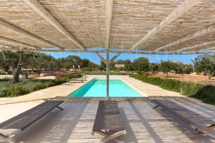 The shaded patio by the pool, for moments of relaxation